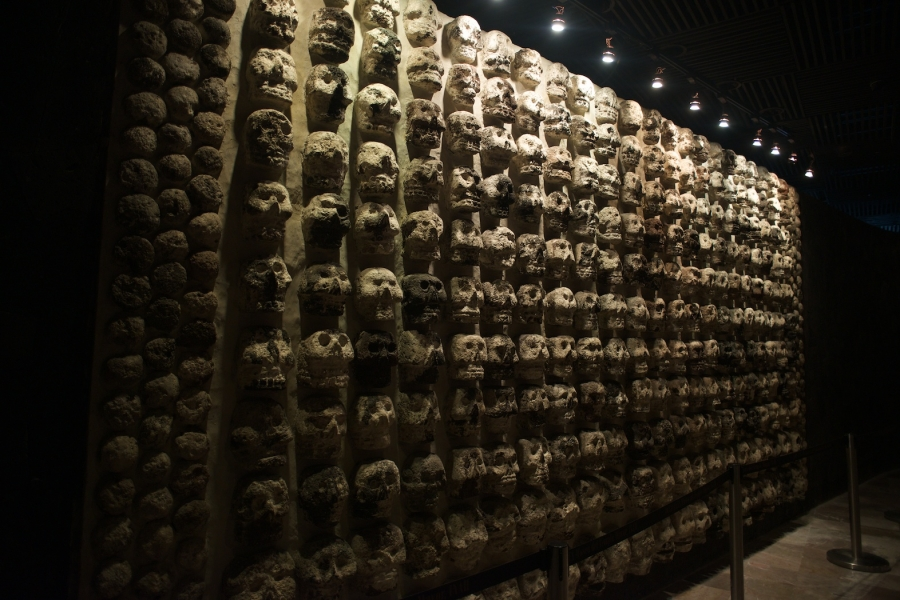 Aztec carved stone wall made entirely of skulls, excavated from Templo Mayor
